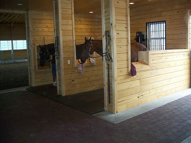 Saddle cutouts on grooming stalls.......Cool idea, but why didn't they make the whole wall like a place to put saddles? Would have been cleaner detail.....