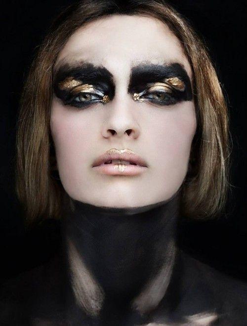 avant garde makeup. gold and black.