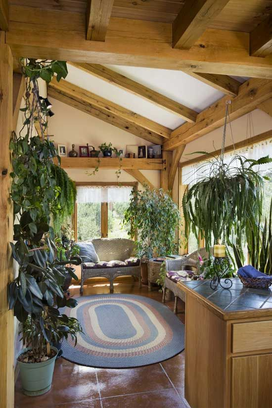 I would love to have this to relax in. timberframe passive solar sunroom