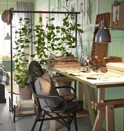 Let nature create two rooms out of one with the help of the PORTIS rolling clothes rack from IKEA and some beautiful plants.
