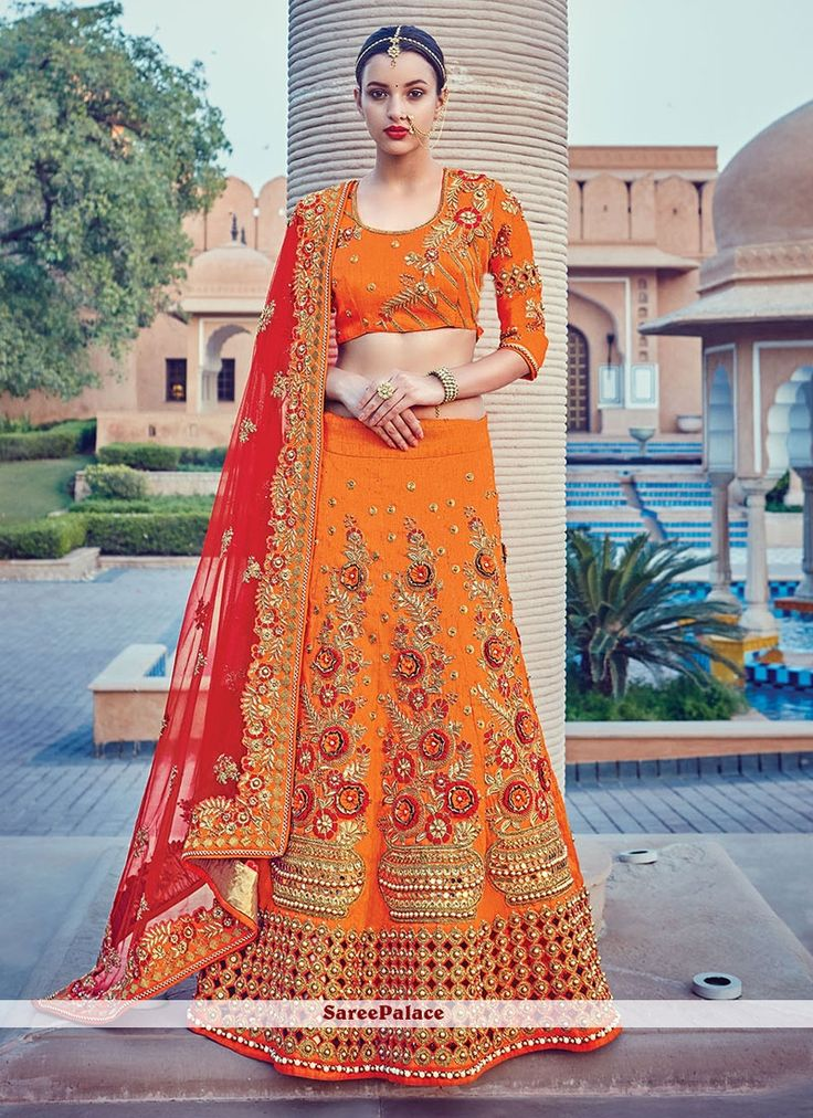 Distinctive Patch Border Work Orange Raw Silk A Line Lehenga Choli