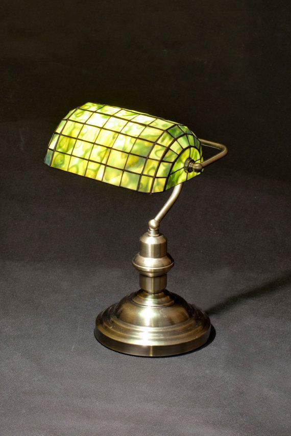 Size: • Height 38 cm (15,5 ) • Diameter of shade 27 cm (11,5 ) • Width of a lamp 21 cm (8,4) Main style of the lamp: banker lamp with unique stained glass shade.   Stained glass lamp, made using L.C. Tiffany metod of copper foil and glass from Uroboros and Youghiogheny. These are American most famous glassworks. Every glass pane is manmade. Solders are very solid and smooth, what guarantee durability for dozens of years. It's handmade product made in Gdansk, Poland. Lamp is very nice in…
