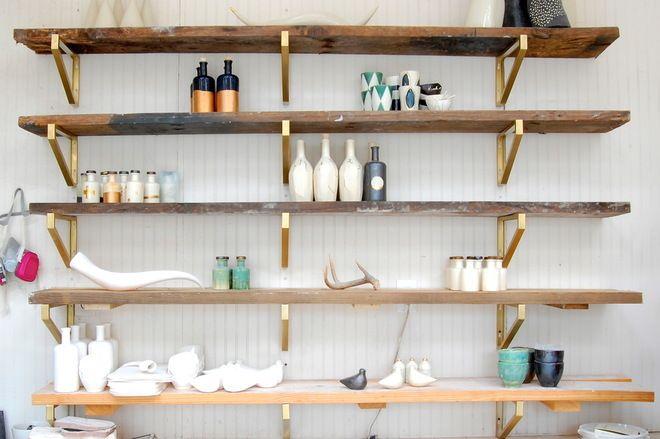 DIY reclaimed wood shelves and ikea brackets sprayed gold.