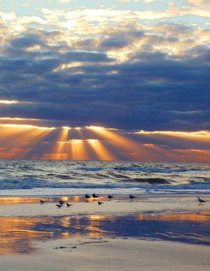 Shafts of sunlight break through the clouds  - Amelia Island, Jacksonville Beach Florida