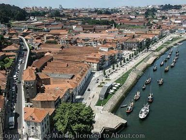 Visit Vila Nova de Gaia and the Famous Port Houses: Vila Nova de Gaia: View Along the Duoro river, with rabelos (traditional port wine transport boats) along the waterfront.