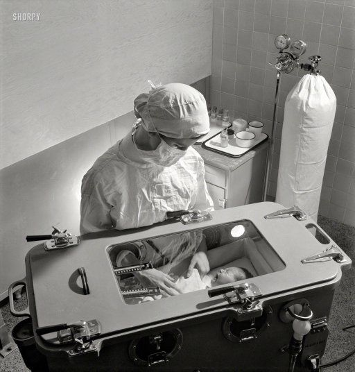 November 1942. Babies' Hospital, New York. Care of prematurely born babies is one of the most complicated procedures which must be learned by the student nurse. Feeding, bathing and diaper changing are carried on inside the incubator, in which temperature, humidity and oxygen must be carefully regulated.