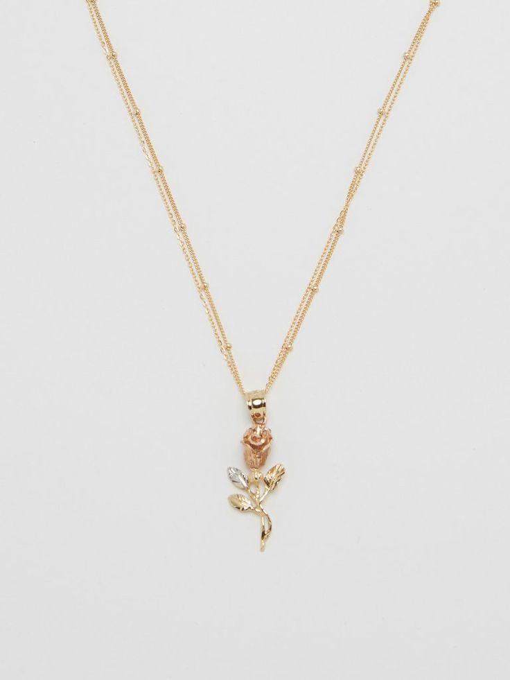 One 14k gold, rose gold and white gold, Rose charm. 2.0 gm Comes with 2 gold filled necklaces.