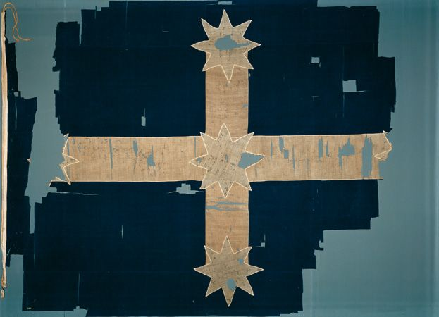 "Original Eureka flag 1854 / The Eureka Flag was flown for the first time on Bakery Hill, Ballarat, Australia, as a symbol of the resistance of the gold miners during the Eureka Stockade rebellion in 1854. Beneath this flag, the miners swore this oath to the affirmation of his fellow demonstrators: ""We swear by the Southern Cross to stand truly by each other and fight to defend our rights and liberties."""