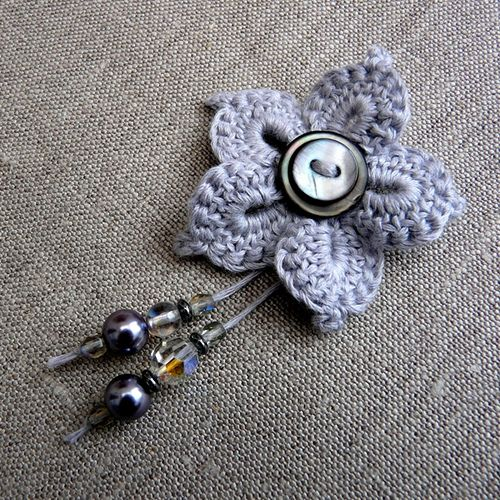 crocheted flower with beads & buttons ... make a pin or add a crocheted long tail ending in beads for a bookmark