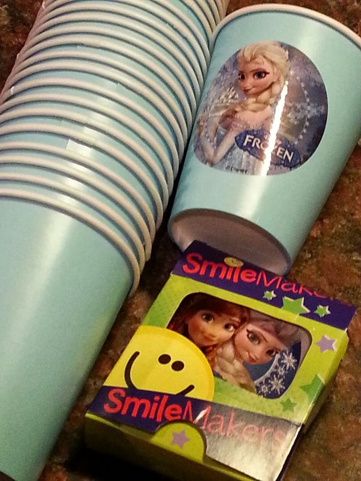 Great idea to put stickers on inexpensive cups for a party theme.