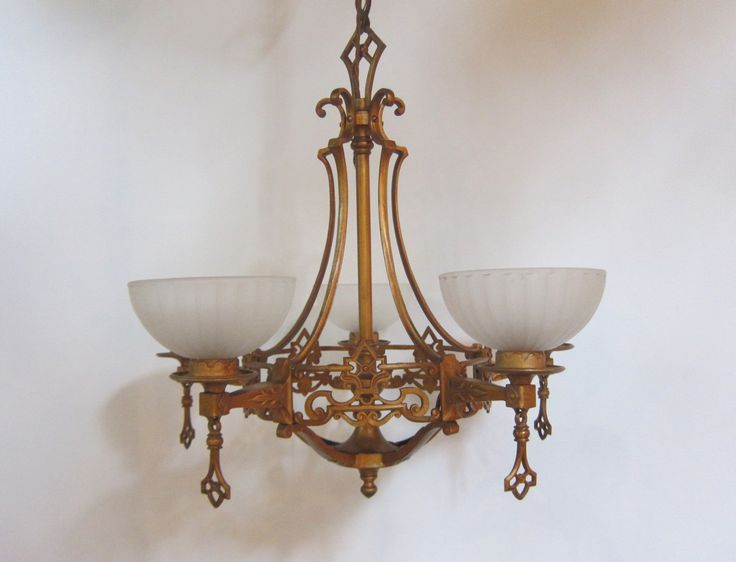 English five arm ceiling light in the original gold finish on brass. The lights has very much a 1930's feel, leaning towards the Gothic.  www.antiquelightingcompany.com