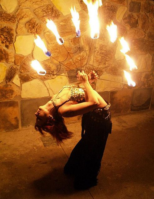Fire performer, environmental portrait inspiration (Fire Fans by Fire Gypsy, via Flickr)