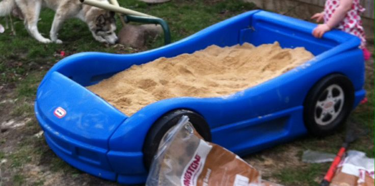 Kids sand box Took old toddler car bed and removed wood panel and placed on bottom and then bought kids play sand at Home Depot for 2.95 a bag. Kids love it. Cheap and affordable.