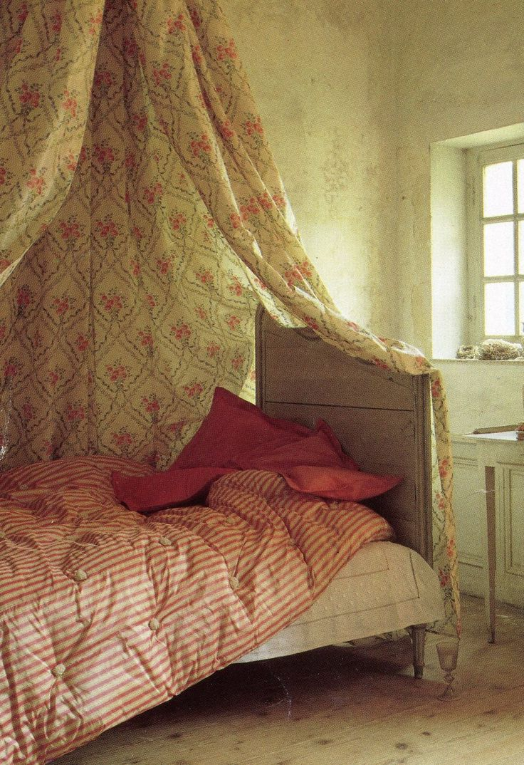Old Russian  dacha with bed corona  and striped eiderdown quilt