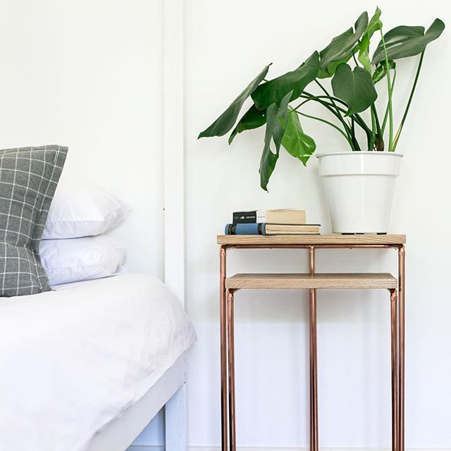 Our Chéne Nesting Tables tucked away as bed side tables ~ an idea for arranging them. #BancHandcrafted