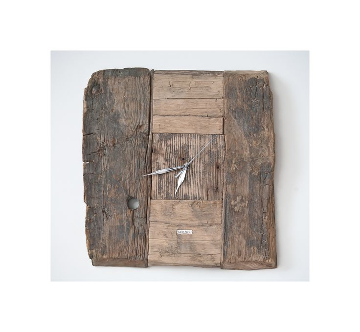 Model no 3. This clock is made of construction wood from the buildings of the Old Town of Gdansk. Black oak dating back to the 14th century. Size: 40 cm x 40 cm.