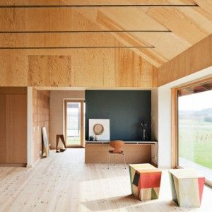 Leth & Gori's low-maintenance Brick House  features clay and plywood surfaces