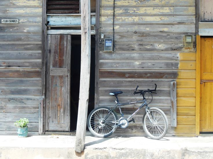 """""""Bicycle and flowers,"""" Baracoa. (Photo by Kathryn MacDonald© at www.travelnotebook.ca)"""