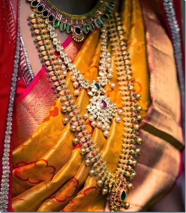 South Indian bride wearing Very large and broad antique haram with combination of small pink pota emeralds and rubies. Gold color South sea ...