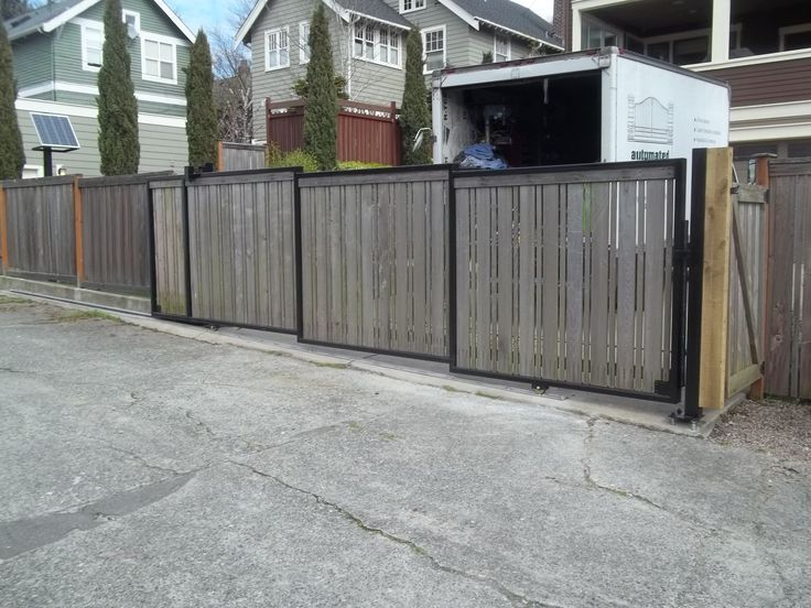 34 best images about wood gates by automated gates on for Wooden sliding driveway gates
