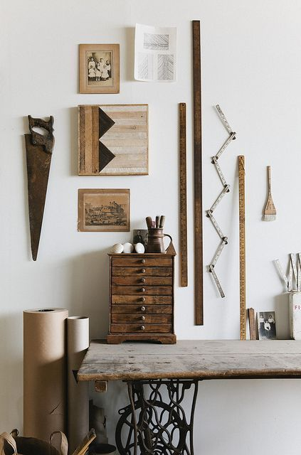 Workspace with vintage wooden tools and rulers.