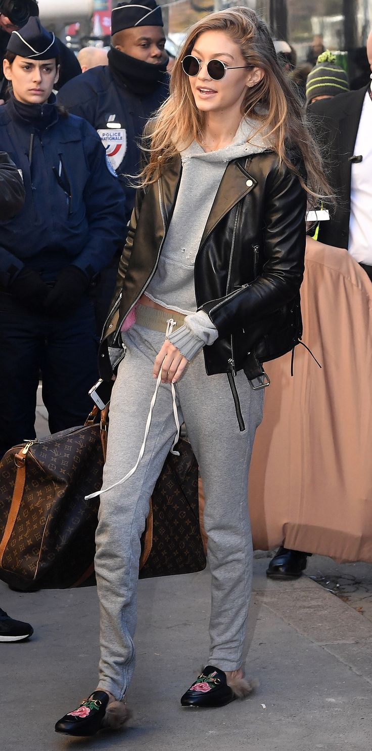 Gigi Hadid - Gucci loafers + Louis Vuitton bag