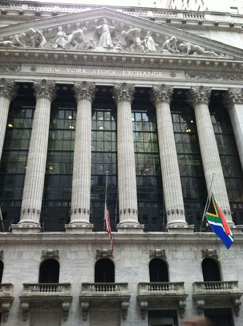 The South African flag flies at half mast today at the New York Stock Exchange in honor of Nelson Mandela.
