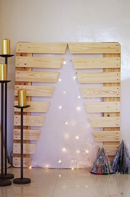 Christmas tree alternative. Would work so well on our outside wall. Definity trying this!