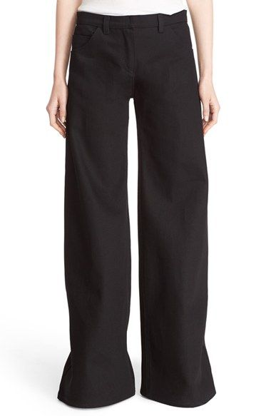 Free shipping and returns on Léa Peckre 'Corm' Flare Leg Jeans (Deep Black) at Nordstrom.com. A floor-skimming flare-leg silhouette creates retro drama for chic five-pocket jeans cut from inky black denim.