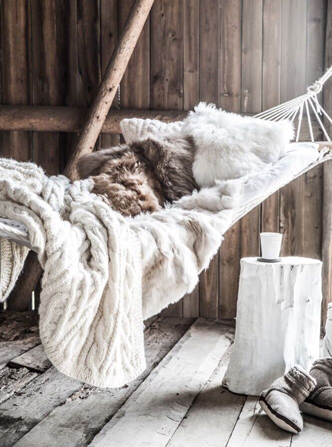 Cozy hammock with cable knit throw.
