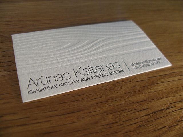 Business card with faux bois embossing