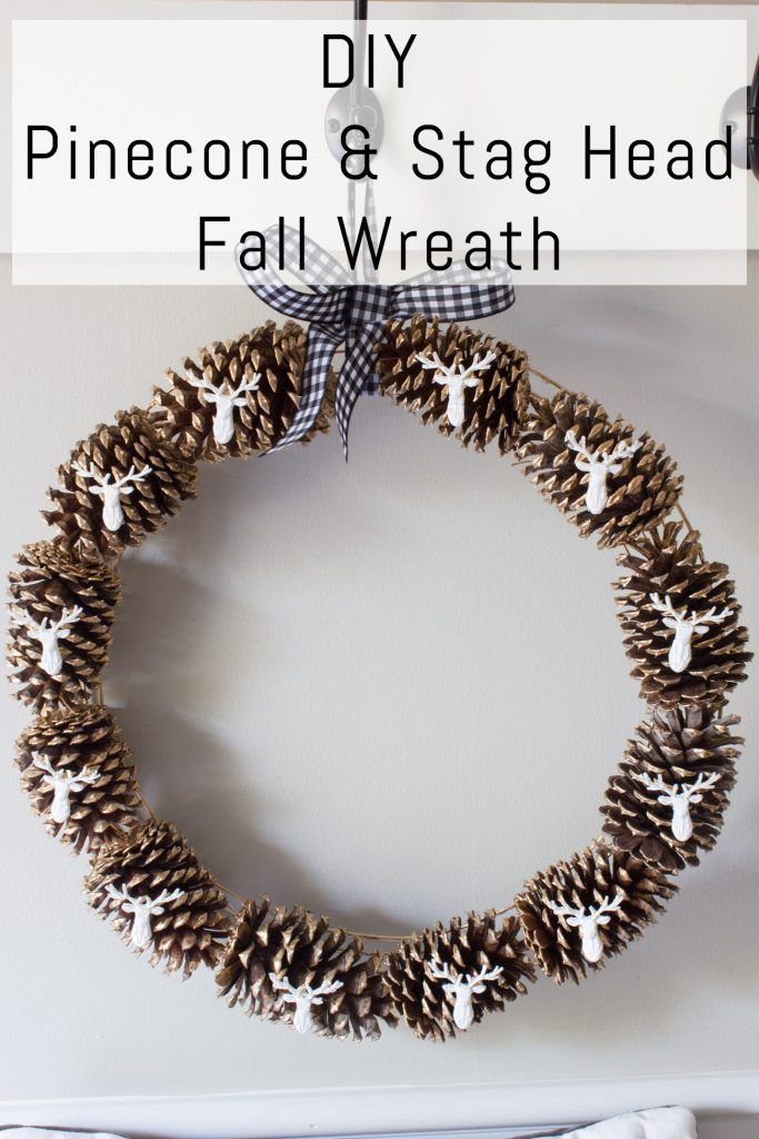 This DIY Pinecone and Stag Head Wreath is perfect for fall and winter! Love that it is simple and classic but elegant. @plaidcrafts #PlaidCreators #ad