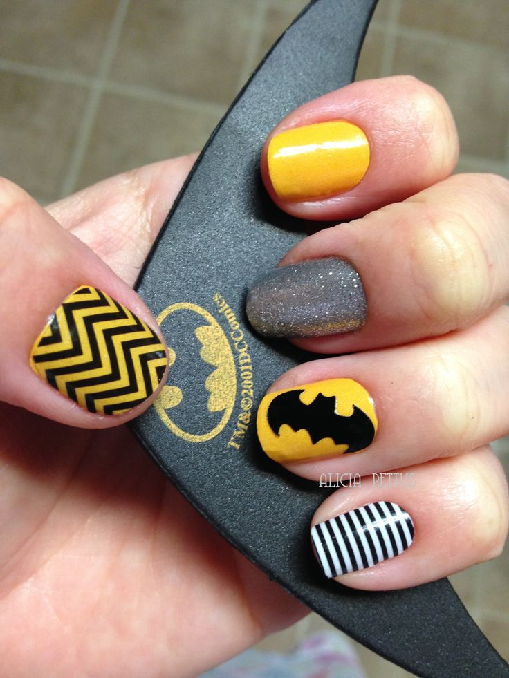 adornbyali@hotmail.com Batman Nails, Sparkle Nails, Superhero Nails, Jamberry Nail Wraps! Lemon Drop Lacquer with Black Chevron and Black & White Skinny. Batsignal is Darkest Black. Message me for more info. Easy DIY Nail Art Manicure.