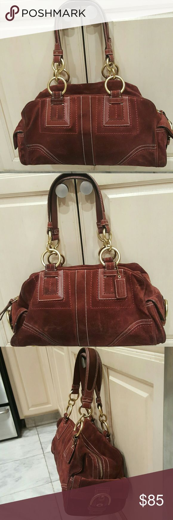 Coach pocketbook Coach doctor style pocketbook,  Burgundy suede,  with gold color hardware.   Suede on both sides slightly darkened due to wearing friction, but otherwise in very good condition.   Lining I'm excellent condition. Coach Bags Satchels