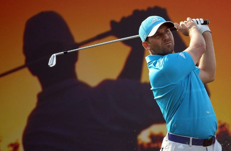 Sergio Garcia hits his shot on the 16th hole during the final round of the Commercial Bank Qartar Masters at the Doha Golf Club, 25 Jan 2014. He won the Masters.