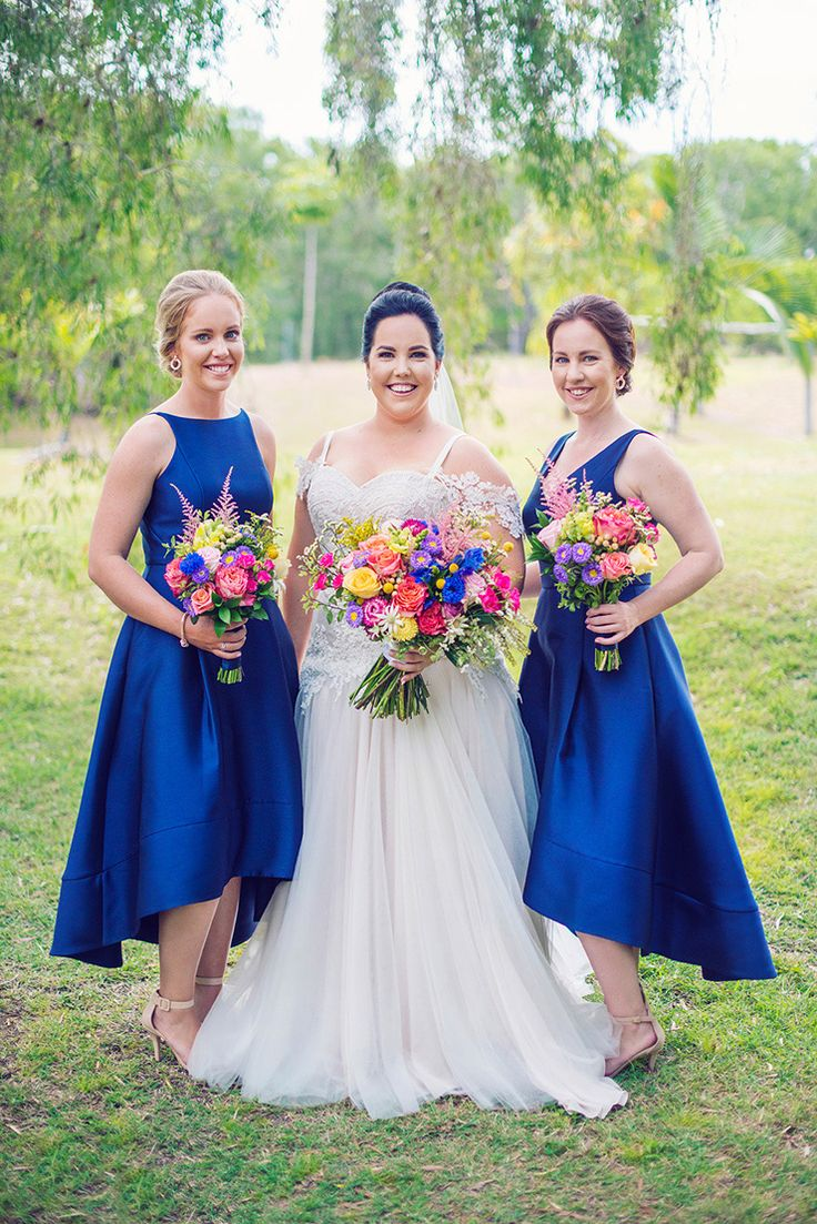 Elegant royal blue bridesmaid dresses and bright rainbow wedding bouquets | Madelyn Holmes Photographics