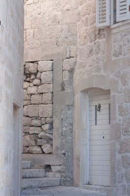 Love the cleaned white stones and this wood paneled door.  #Korcula