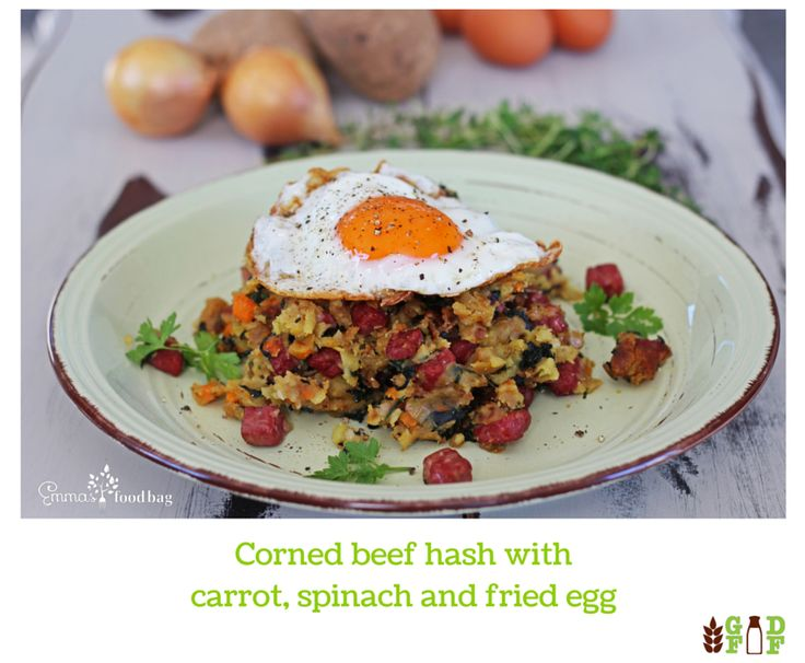 Corned beef hash with carrot, spinach and fried egg