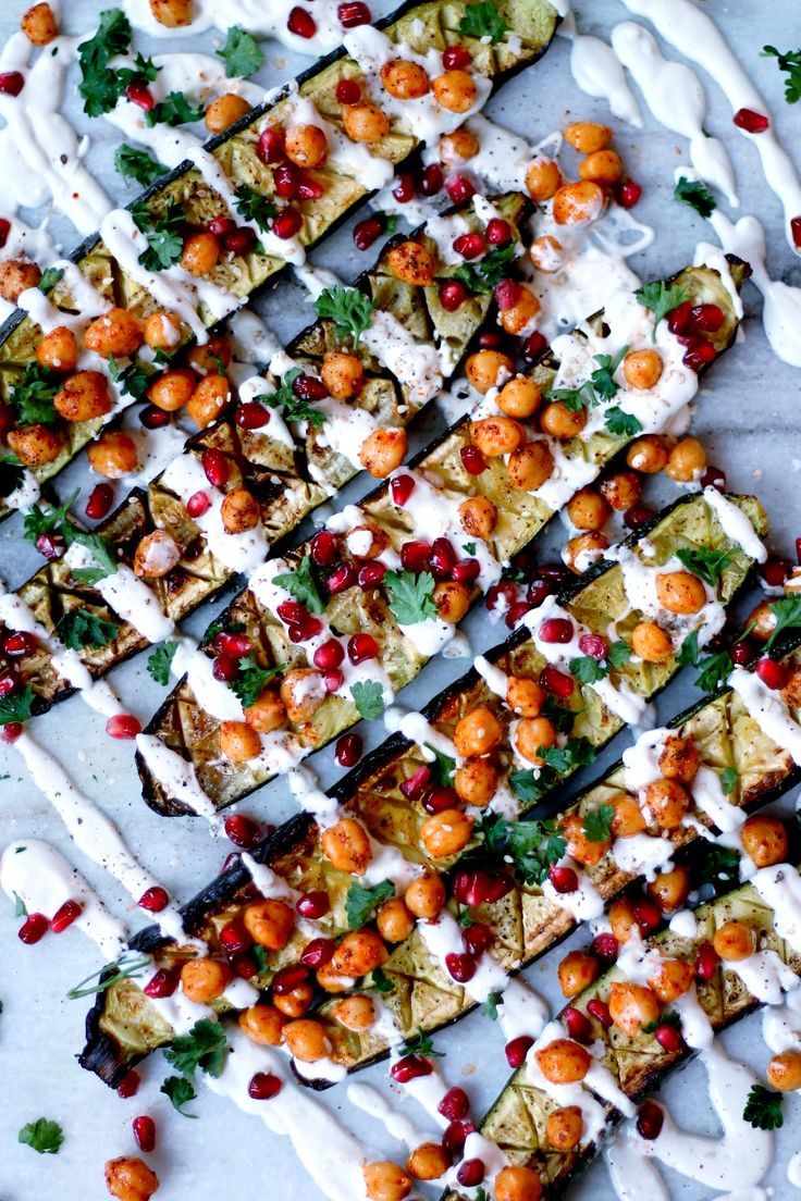 Oven Roasted Zucchini with Chickpeas and Cashew Cream Drizzle, ohhh my goodness.Anyone who claims not to like vegetables has yet to try this dish! These