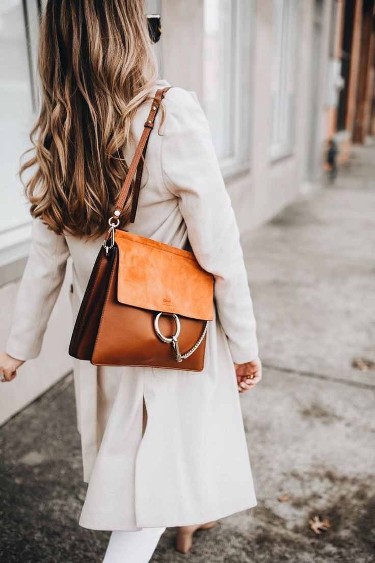 All white outfit paired with a brown bag for Fall #fallstyle