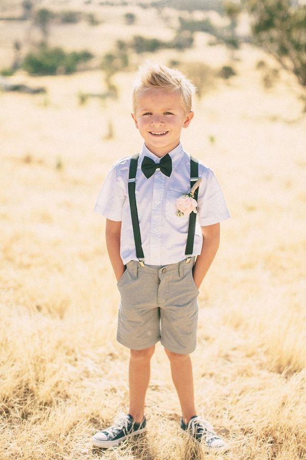 Suspenders, shorts and Chucks. We're digging this chill ring bearer look