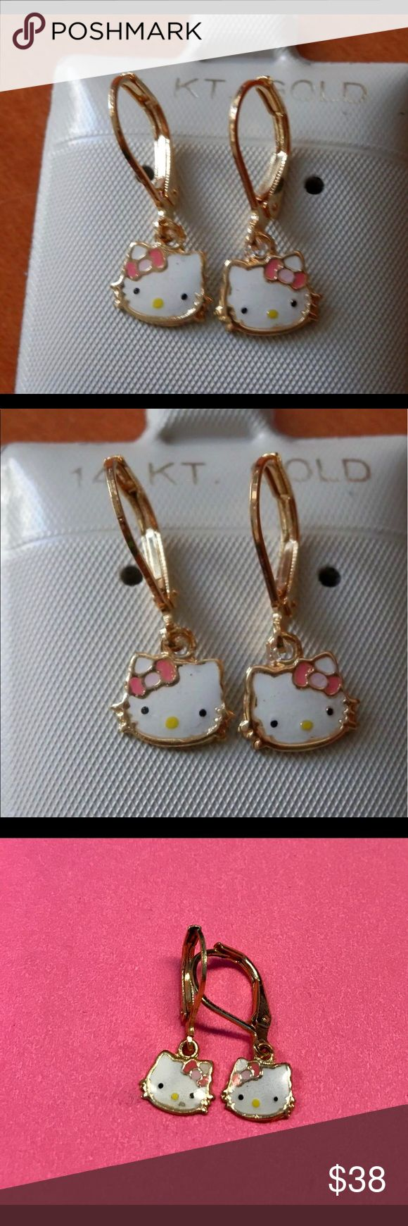 14K Gold Filled Pink Hello Kitty hang Earrings 14K Gold Filled Pink Hello Kitty hanging Earrings.  Please see one of them has gold flake on Hello Kitty's cheek see in the pics number three and four pics actual Earrings. Super cute earrings adult or child. Hello Kitty Jewelry Earrings