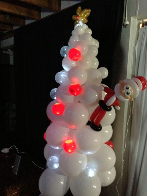 "The balloon Christmas Trees were inspired by David Taylor from MAD Balloons Sydney and the gorgeous Santa was made my Matt Russell AKA TwistedMR.  The tree's baubles are lit up with Party Dots inside of small 5"" balloons."