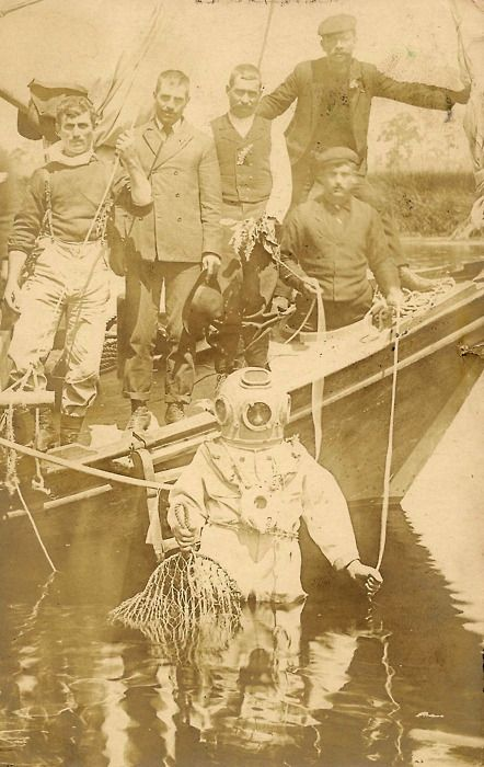 decrepit-telephone:  Sponge diver and five men on a boat, Tarpon Springs, Florida. Real photo postcard, ca 1907.
