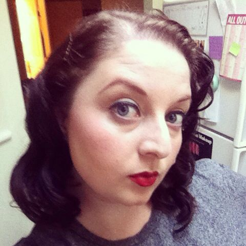 Red lips, bold liner, and 50's retro hair
