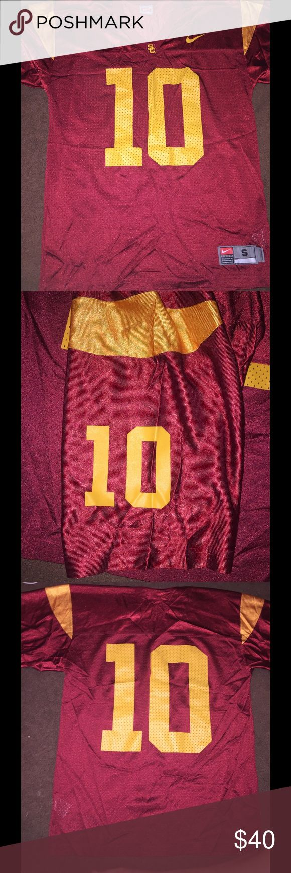 Nike USC-University of Southern California Jersey This football jersey is in great condition. It has barely been worn. It's a size small and is perfect for game days. Nike Tops Tees - Short Sleeve
