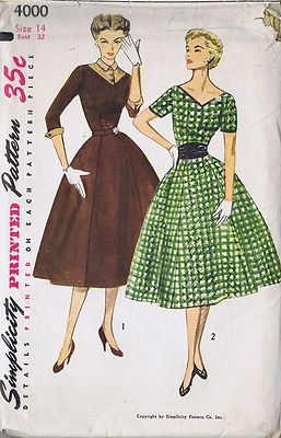 Vintage 50's 1 Piece Dress Pattern with Detachable Cuffs Dickey and Cummerbund Full skirt and bodice with wide V shaped front and back neckline style Dress pattern. View 1 three buttons fasten Dickey which has a small pointed collar. Detachable Dickey and Cuffs of the three quarter length sleeves are contrasting. View 2 features short sleeves and is trimmed with contrasting neck and sleeve bands. Wide waist-accenting Cummerbund is also of contrasting fabric.