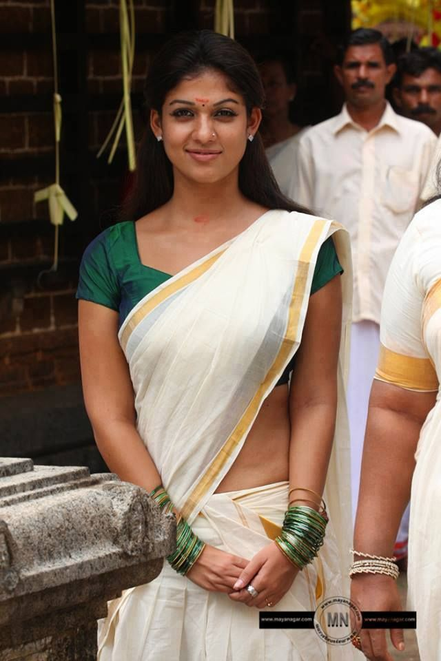 Nayantara in Kerala saree, Awesome look in green blouse and nude gap below blouse and hip