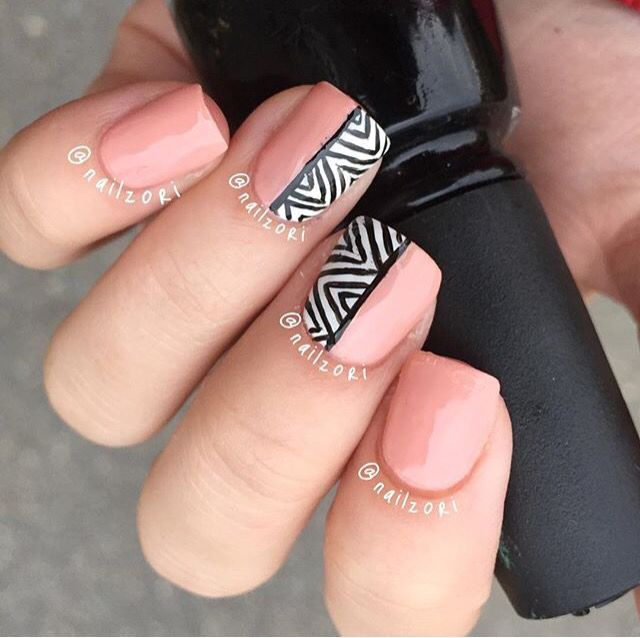 Pink and black aztec nail design.