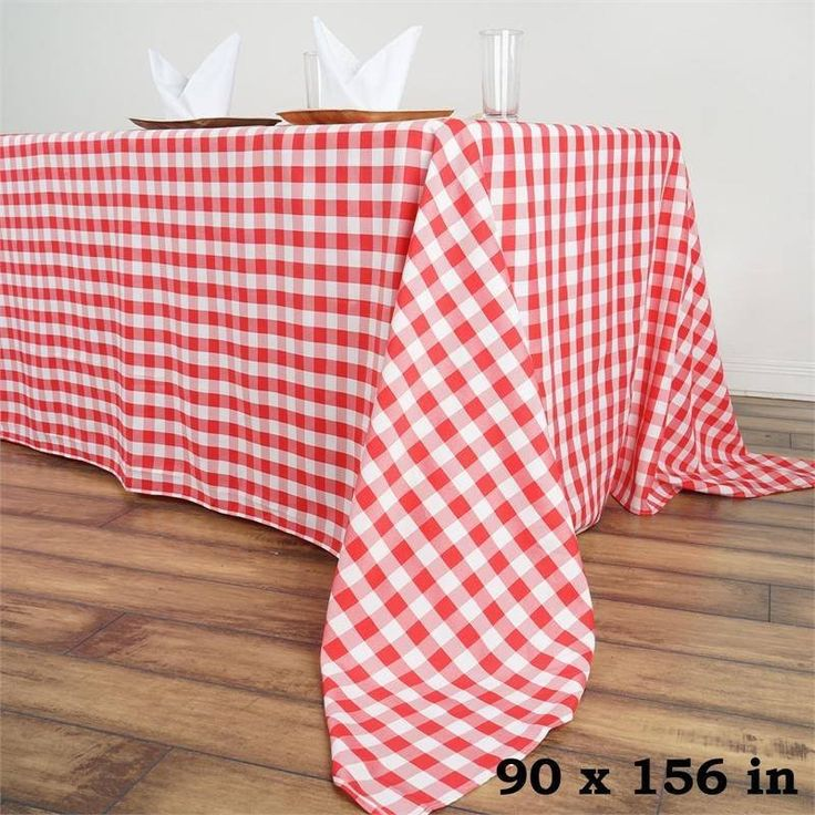 """90x156"""" White/Red Perfect Picnic Inspired Checkered Polyester Tablecloths /  Now you can relish that spring picnic feeling any time anywhere with our Perfect Picnic Inspired Checkered Polyester tablecloths. The inspiring and recreational checkered design brings back the memories of happy picnic times in gardens and by the river side. Create a peaceful and serene party ambiance with our luxury Polyester tablecloths fashioned in chic checkered design to exude positive energy and a classy look…"""